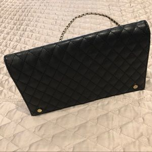 Black quilted purse with detachable chain